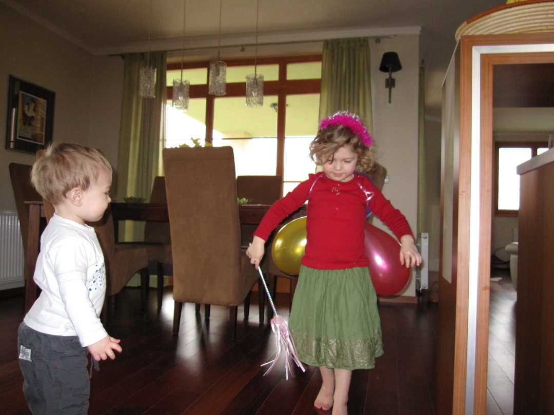 Anna in fairy costume dancing & Oliver watching