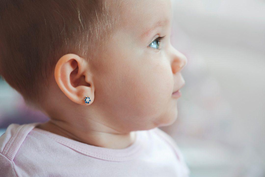 baby girl with earrings
