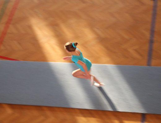 Anna at a gymnastics meet running to the vault