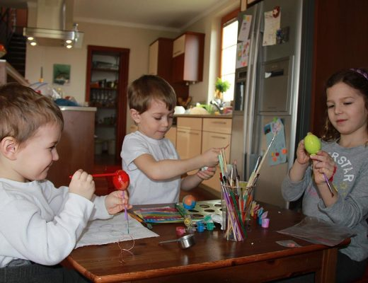 Samuel, Oliver, and Anna painting easter eggs