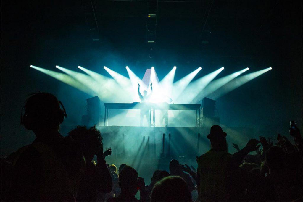 Listening to a DJ in a club