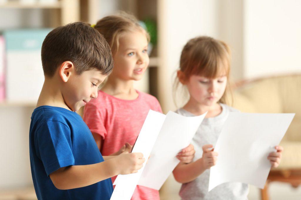 Cute kids singing in music class
