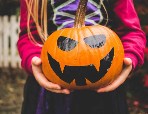 Child holding jack-o-lantern photo by Julia Raasch (@julesrsh) on Unsplash