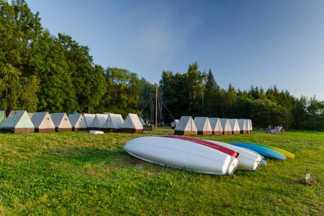 Sumer's tent camp with canoe, Slezska Harta, Czech Republic