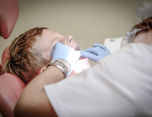 Boy getting his teeth examined by a dentist