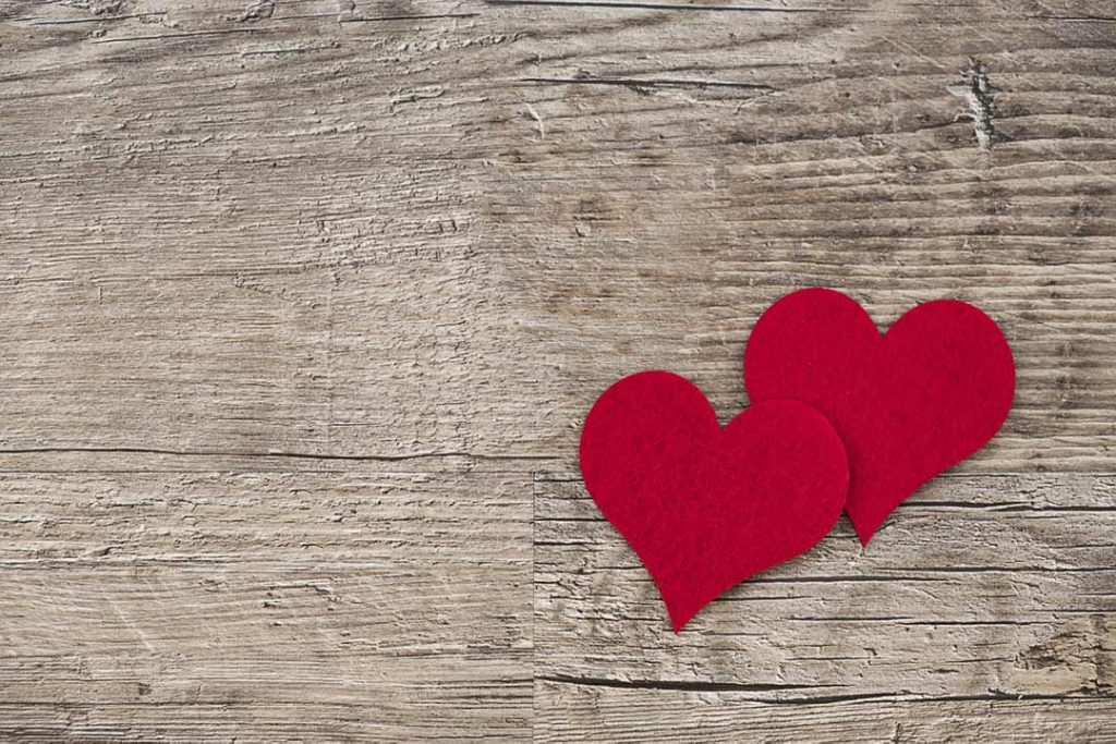 Two hearts on wooden surface