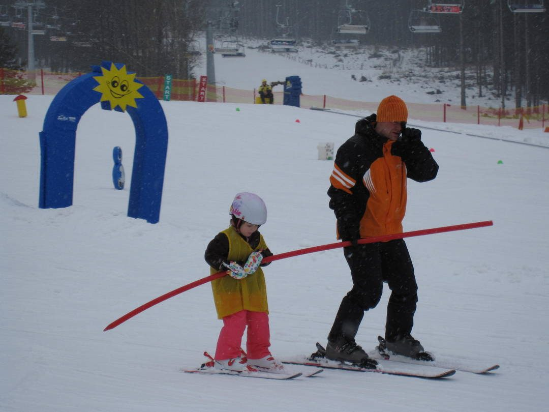 Anna skiing with instructor