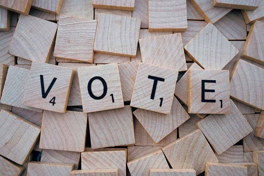 scrabble letters spell vote
