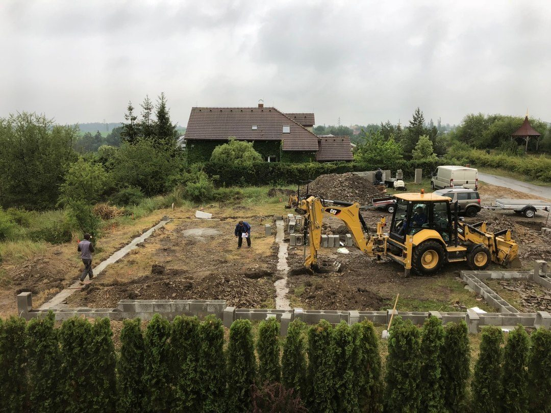 empty lot with two diggers and ditches dug