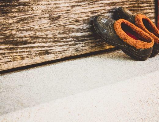 slippers leaned against bench